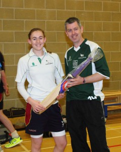 Lucy receiving her bat from Chairman, Nick Rivett